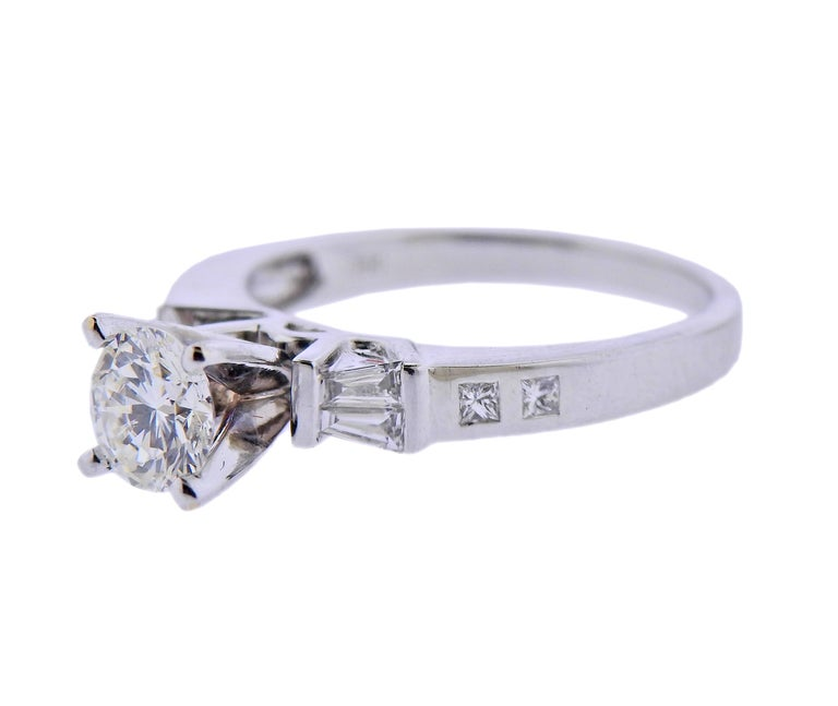 18k white gold engagement ring, with center approx. 0.65ct H-I/VS1-VS2 diamond, and 0.24cts in side diamonds. Ring size - 5.5. Marked: D024, 750. Weight - 3.6 grams.