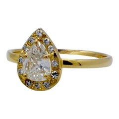 0.65 Carat Diamond Pear Shape with Diamond Halo Engagement Ring