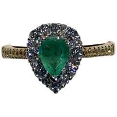 0.65 Carat Pear Shaped Emerald Diamond Halo Ring