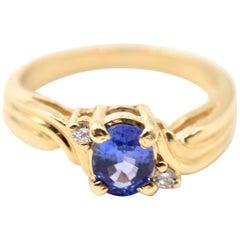 0.65 Carat Tanzanite and Diamond 14 Karat White Gold Ring