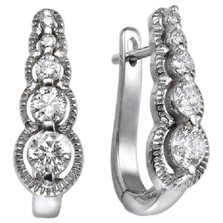 0.66 Carat 14 Karat White Gold Drop Dangle Round Diamond Earrings For Sale
