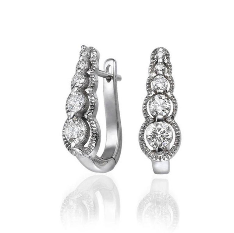 A handmade Diamond dangle earrings made of 14K White Gold set with 10 Diamonds.   The total carat weight of these beautiful Diamond drop earrings is 0.66 carat.        Item Specs:  Color: F-G     Clarity: VS-SI         Main Stone:     These dangle