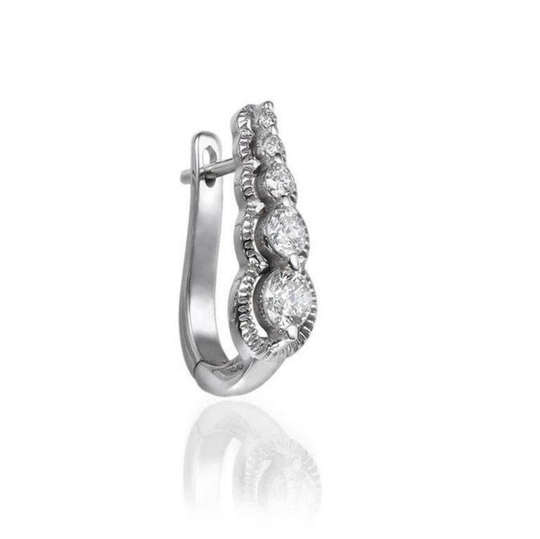 Round Cut 0.66 Carat 14 Karat White Gold Drop Dangle Round Diamond Earrings For Sale