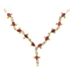 0.66 Ct Oval Rubies and 0.11 Ct Round Diamonds on a 18k Yellow Gold Necklace