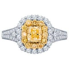 0.68 Carat Fancy Yellow Diamond in 18 Karat Gold Cushion Shaped Double Halo