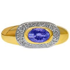 0.68 Carat Oval-Cut Tanzanite and 14 Karat Yellow Gold Engagement Ring