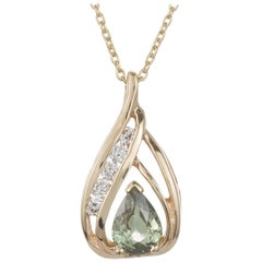 0.68 Carat Pear Shaped Alexandrite and White Diamond Pendant in 14 Karat Gold