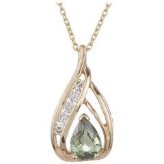 0.68 Carat Pear Shaped Alexandrite and White Diamond Pendant in 14 Karat Gold