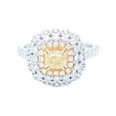 0.69 Carat Cushion Yellow Diamond White Diamond Halo Ring Set in 14 Karat Gold