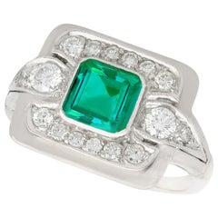0.69 Carat Emerald and 0.52 Carat Diamond, Platinum Dress Ring