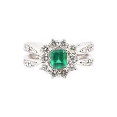 0.69 Carat, Natural Emerald and Diamond Halo Estate Ring Set in Platinum