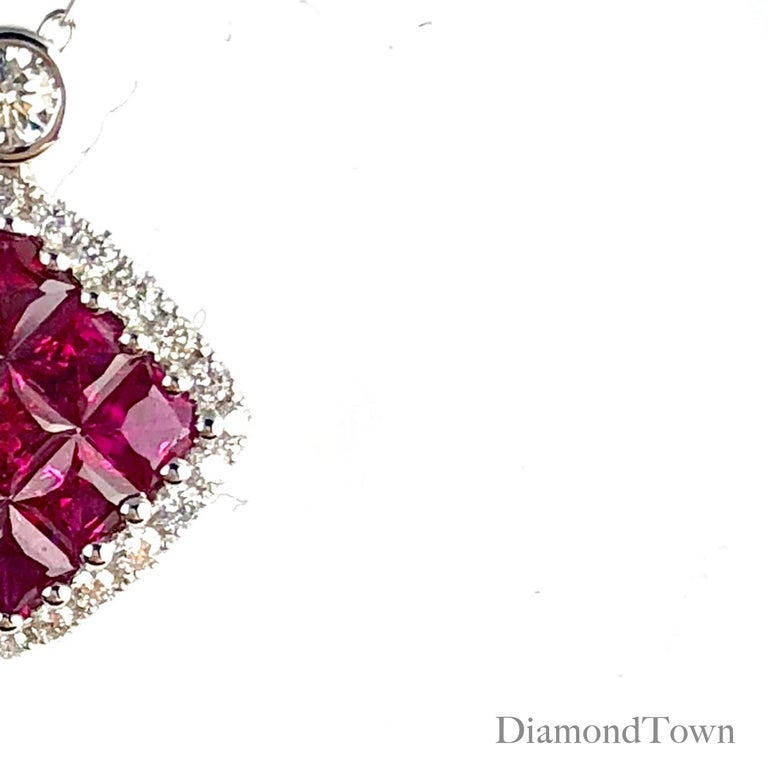 This pendant features a ruby cluster square center (nine stones, total weight 0.70 carats), surrounded by a halo of white diamonds (total diamond weight 0.19 carats) set in 18k White Gold.  An insurance appraisal certificate (COA) will be included.
