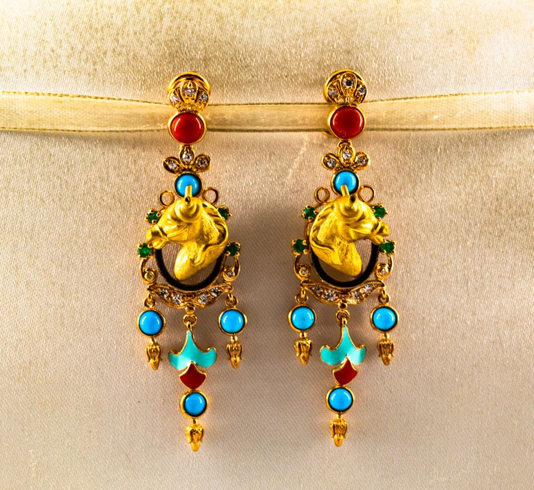 These Earrings are made of 9K Yellow Gold. These Earrings have 0.40 Carats of White Modern Round Cut Diamonds. These Earrings have 0.30 Carats of Emeralds. These Earrings have also Mediterranean (Sardinia, Italy) Red Coral, Turquoise and