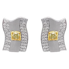 0.70 Carat Fancy Intense Yellow Diamond & 1.01 Carat White Diamond Stud Earring