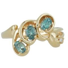 0.71 Carat Oval Alexandrite Diamond Three-Stone Cluster Ring 18K Yellow Gold