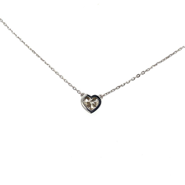 A necklace to steal your heart - fall in love with this sweet 0.72 Carat GIA Heart Shaped Diamond 18 Carat White Gold Necklace. Classically bezel set with a beautiful 45cm 18 carat white gold chain and parrot clasp.   Wear it with other necklaces