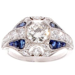 0.72 Carat Round Brilliant Cut Diamond Sapphire Platinum Ring