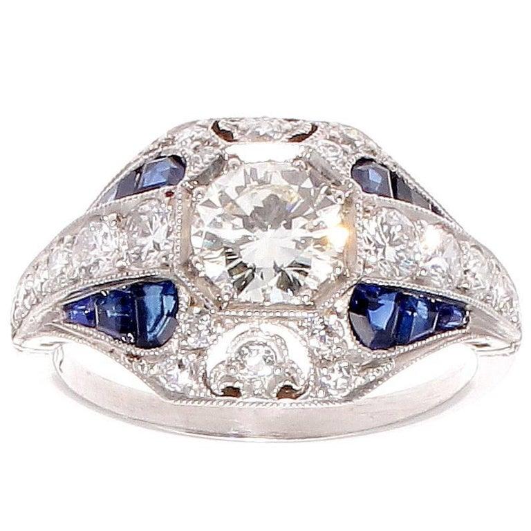 0.72 Carat Round Brilliant Cut Diamond Sapphire Platinum Ring