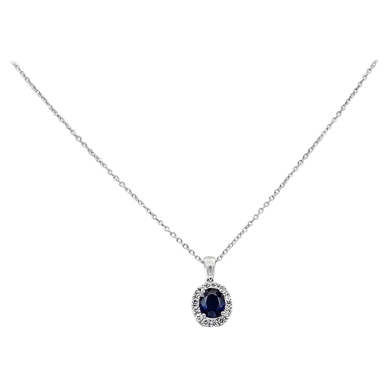 0.73 Carat Blue Sapphire and Diamond Halo Pendant Necklace