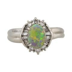0.73 Carat Oval Opal Bezel Set Diamond Cocktail Ring Platinum in Stock
