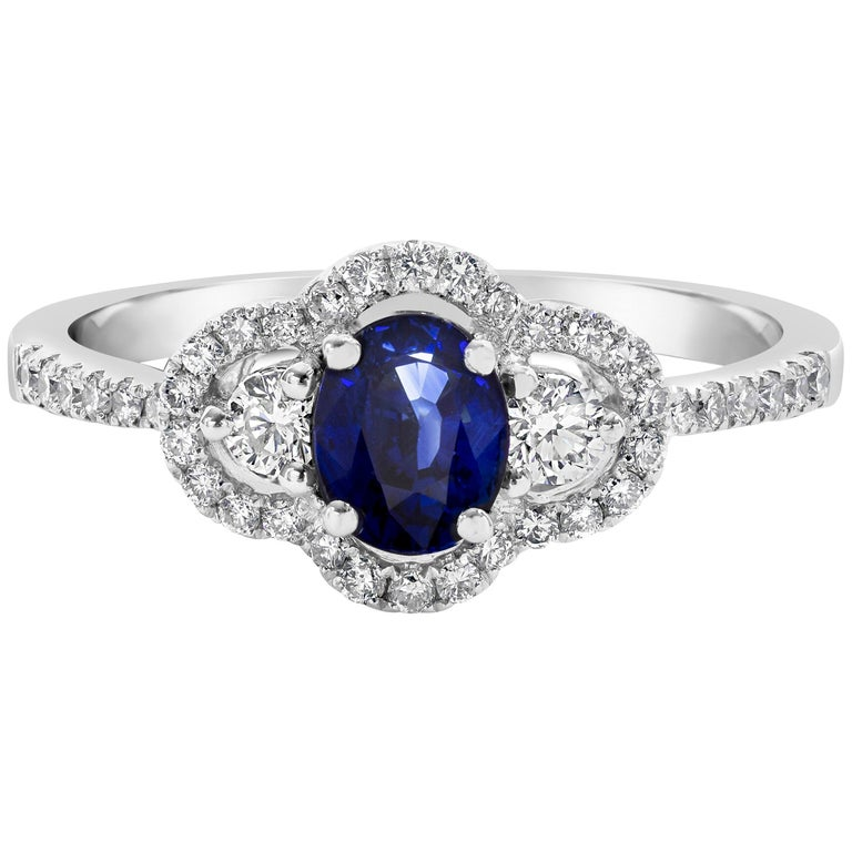 0.74 Carat Blue Sapphire and Diamond Three-Stone Engagement Ring For Sale