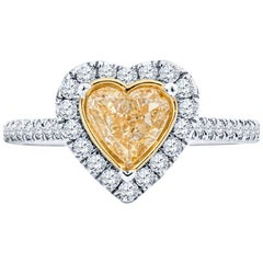 0.74 Carat Fancy Intense Yellow Heart Diamond 18 Karat White Gold Ring, GIA