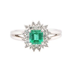 0.74 Carat Natural Emerald and Diamond Cluster Ring Set in Platinum