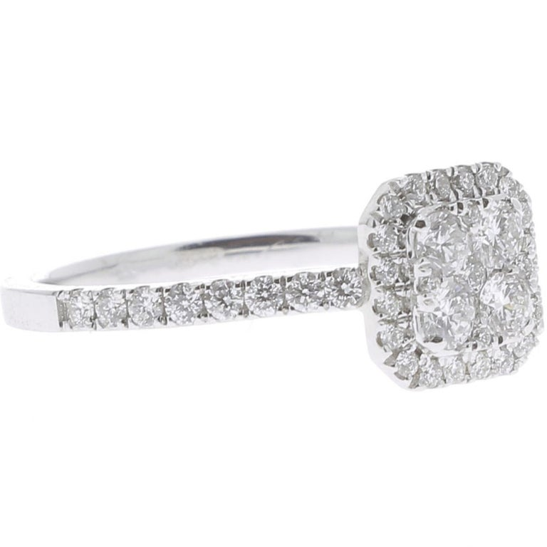 The Cushion Ring is a unique and trendy ring set with 0,74 carat. The Wedding Ring is set with Brilliants and paved with 4 Diamonds. The Ring is in 18K White Gold. The Diamonds are GVS quality. The ring size is 6 ½ US and can be size.