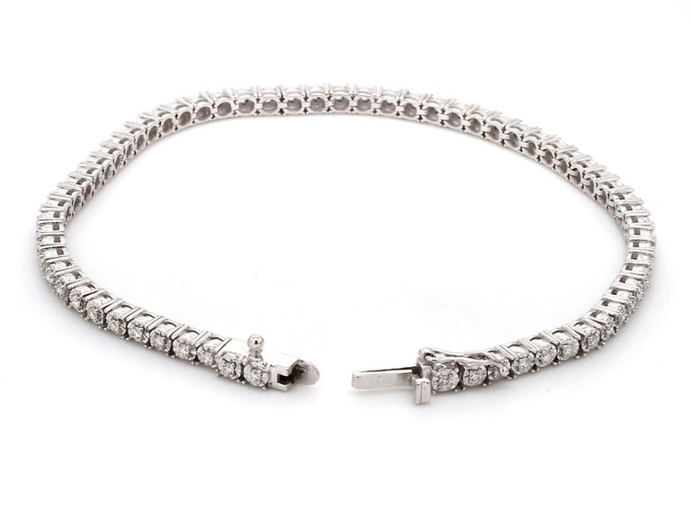 A Beautiful Handcrafted Flexible Tennis Bracelet in 18 Karat White Gold  with Diamonds Studded Motif . A perfect Daily wear Jewelry  Natural Diamond Details Pieces : 65 Pieces Weight : 0.75 Carat  Clarity of Diamond : VS Colour of Diamond : G/H