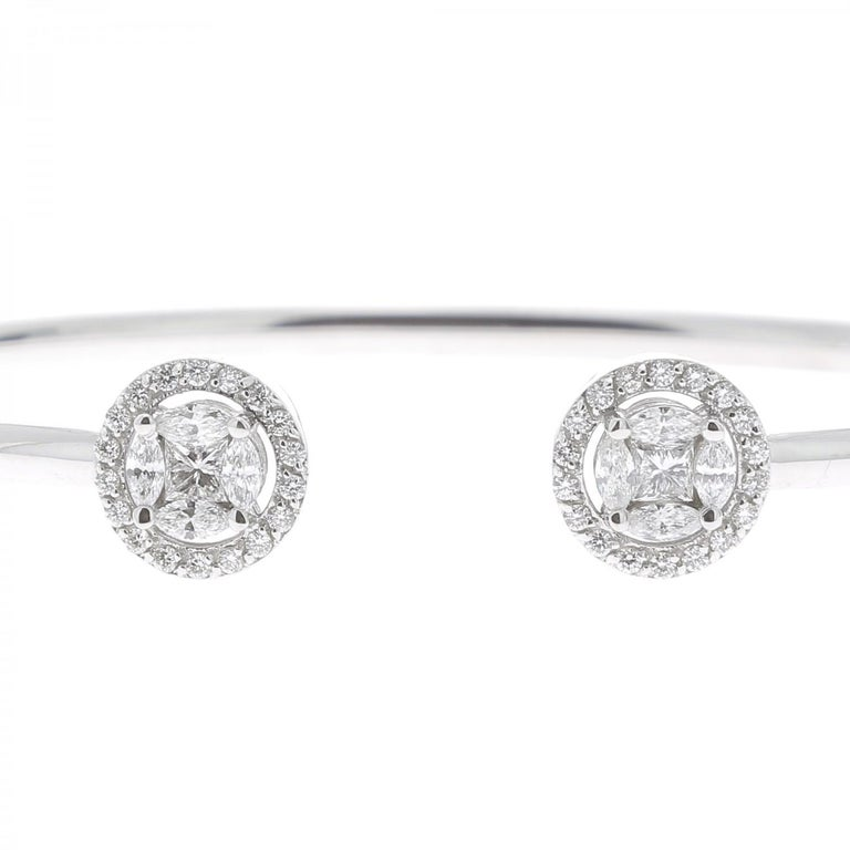 An amazing Diamond Bangles Bracelet set with 4 Marquise Diamonds and Round Diamonds weighing 0.75 Carats. The Diamonds are GVS quality. The Bangle Bracelet is made of 18K White Gold. The Diamond Bracelet weight 8.11 Grams. The Diameter of the