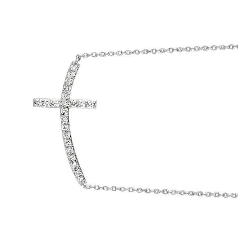 0.75 Carat Natural Diamond Cross Pendant Necklace 14K White Gold G SI 18'' chain        100% Natural Diamonds, Not Enhanced in any way Round Cut Diamond Necklace       0.75CT     G-H      SI       14K White Gold    Pave style  3.8 gram     11/16