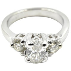0.75 Carat Oval Diamond Three-Stone Platinum Engagement Ring