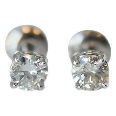 0.75 Carat Total Diamond and 14 Karat White Gold Screw Back Stud Earrings