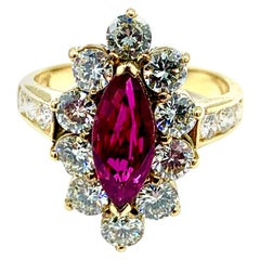 0.76 Carat Marquise Ruby and Round Brilliant Diamond Yellow Gold Ring