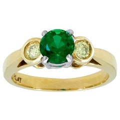 0.76 Carat Round Green Emerald and Yellow Diamond Three-Stone Engagement Ring