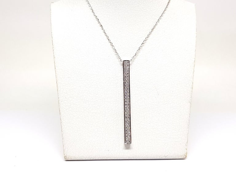 Gold: 18K White gold  Weight: 6.38 grams.  Diamonds: 0.77ct. colour: G clarity: VS  Length Pendant: 5.00 cm.  Width Pendant: 0.40 cm.  Length chain: choose between 40, 42, 45 or 50cm.  All our jewellery comes with a certificate and a 5 year