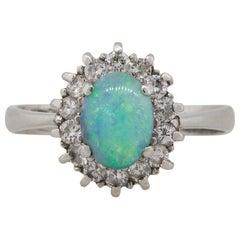 0.78 Carat Black Oval Opal Diamond Halo Ring Platinum in Stock