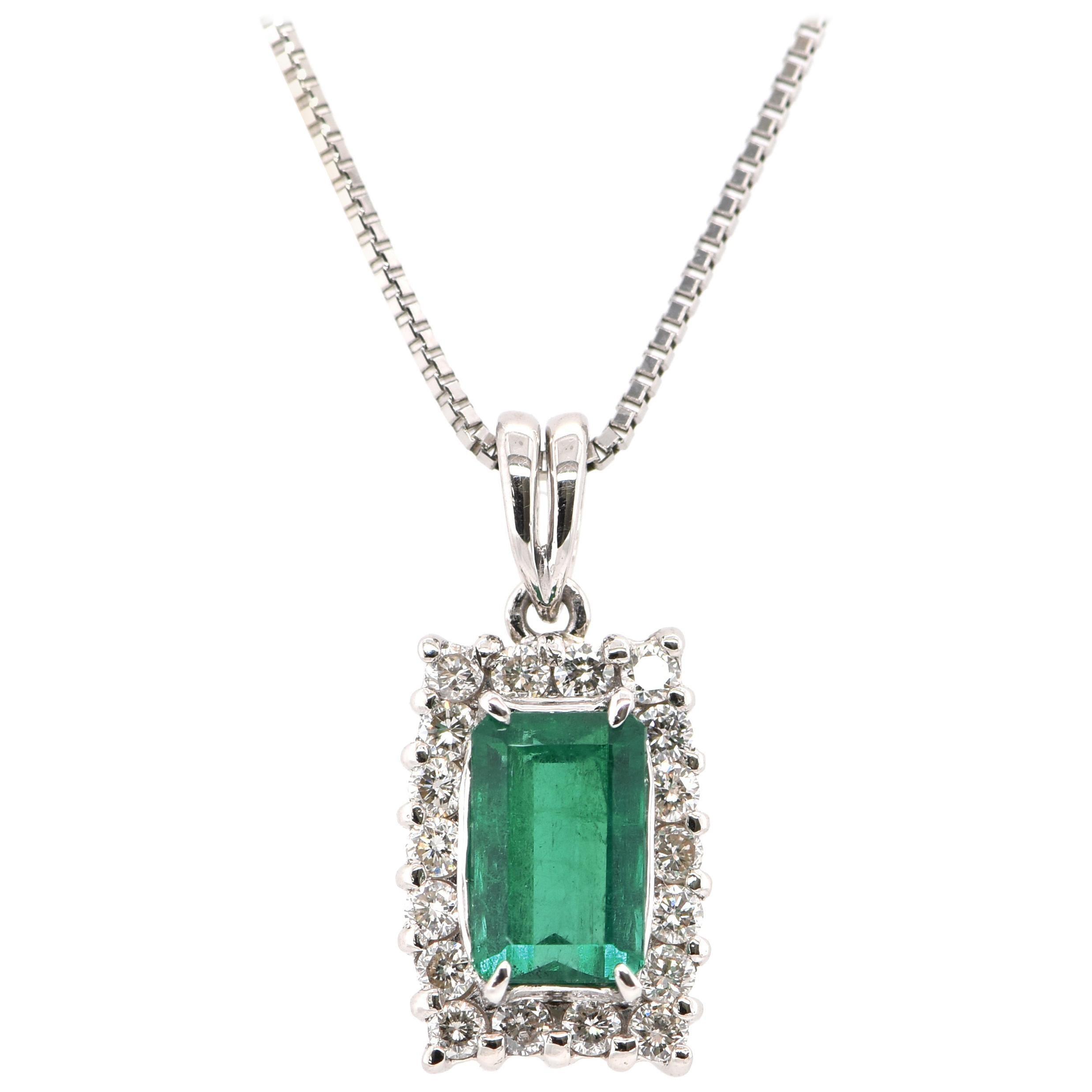 0.78 Carat Natural Emerald and Diamond Pendant Set in Platinum