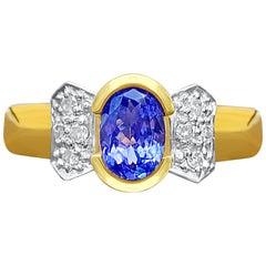 0.78 Carat Oval-Cut Tanzanite, Diamond and 14K Yellow Gold Engagement Ring