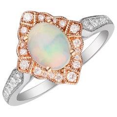 0.79 Carat Ethiopian Opal and Diamond 14 Karat Two-Tone Ring