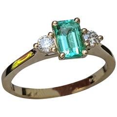 0.8 Carat 14 Karat Yellow Gold Emerald and Diamond 3-Stone Engagement Ring