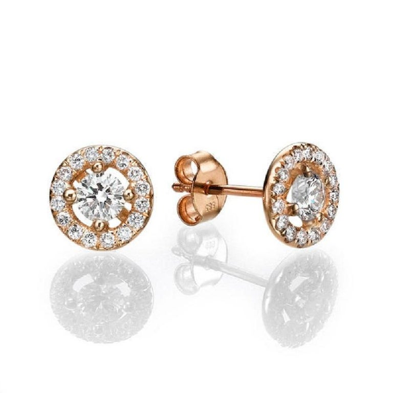 A beautiful Diamond stud earrings made of 14K Rose Gold set with a pair of excellent Round cut Diamond of SI1 clarity and F color accented by 30 natural round diamonds. The total carat weight of these Diamond studs is 0.80 carat.    Center Stone:
