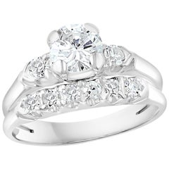 Approximately 0.6 Ct Solitaire Round Center Diamond 14 Kt White Gold Ring & Band