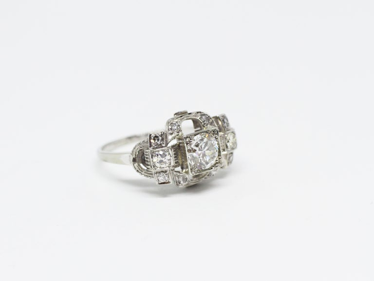 Beautiful handmade Art Deco engagement ring set with an old European cut diamond weighing 0.80 carats in the centre, complimented by 5 eight cut diamonds on either side within a very intricate mount.  The rings design is a semi-dome, open work and