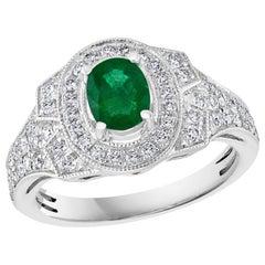 0.80 Carat Oval Cut Emerald and 0.85 Carat Diamond Ring 18 Karat White Gold