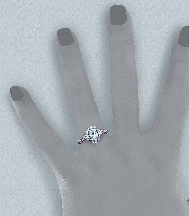Contemporary GIA Certified 0.80 Carat Oval Diamond Engagement Ring in White Gold Halo Setting For Sale