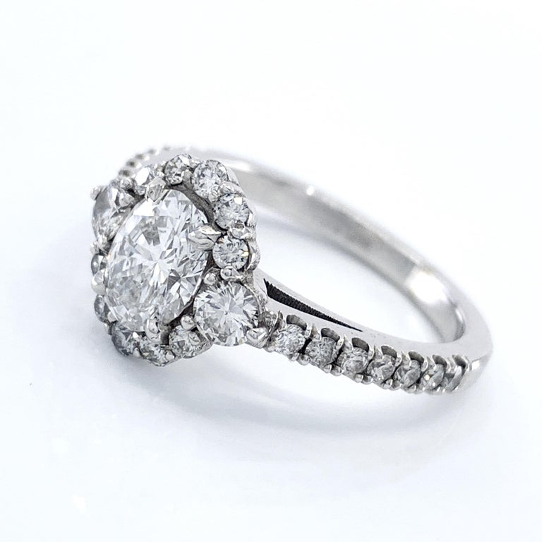 Brilliant Cut GIA Certified 0.80 Carat Oval Diamond Engagement Ring in White Gold Halo Setting For Sale