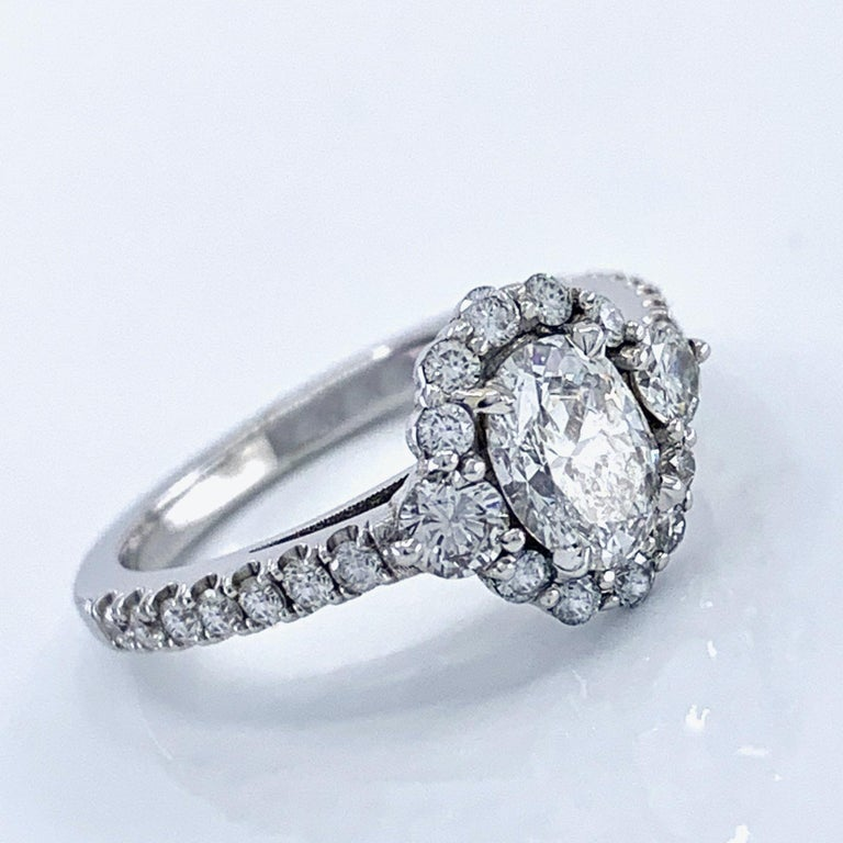 GIA Certified 0.80 Carat Oval Diamond Engagement Ring in White Gold Halo Setting In New Condition For Sale In Sherman Oaks, CA