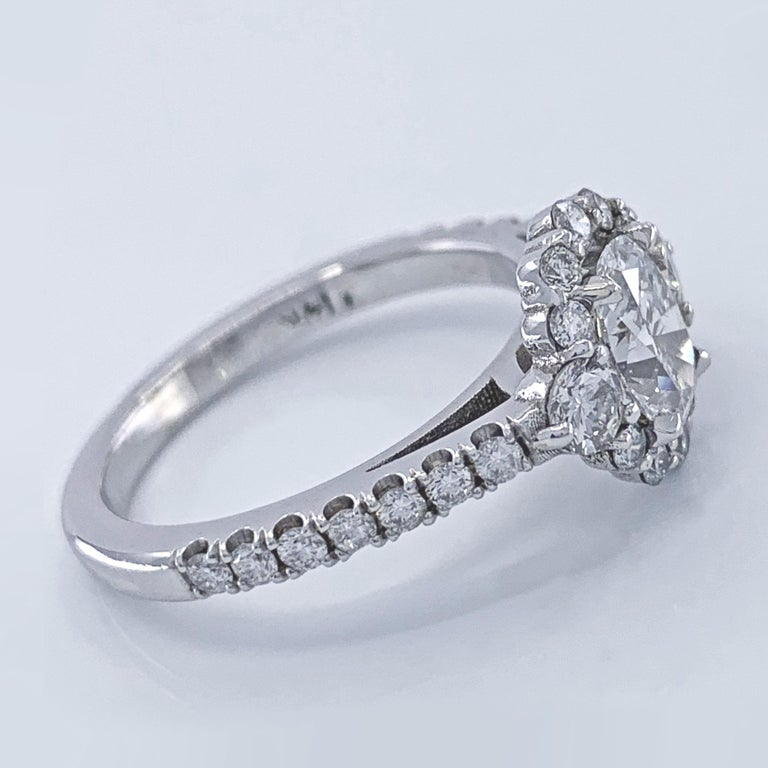 GIA Certified 0.80 Carat Oval Diamond Engagement Ring in White Gold Halo Setting For Sale 2