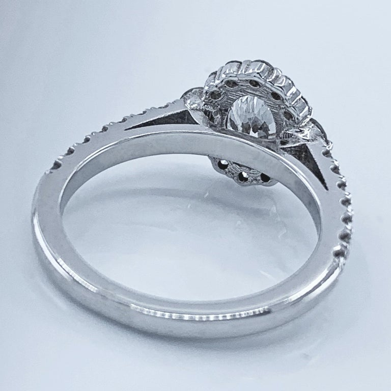 GIA Certified 0.80 Carat Oval Diamond Engagement Ring in White Gold Halo Setting For Sale 3